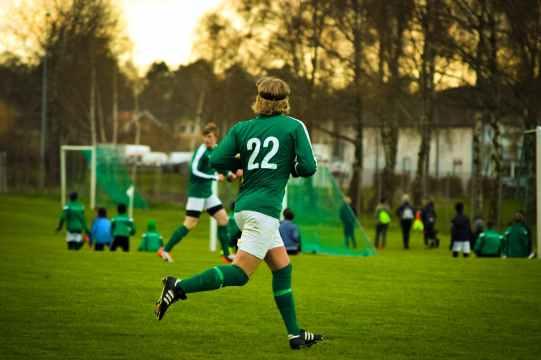 athletes field football football players